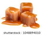 caramel candies with caramel... | Shutterstock . vector #1048894010