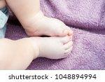 baby feet in mother hands. tiny ... | Shutterstock . vector #1048894994