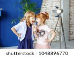 two little funny children sing...   Shutterstock . vector #1048896770
