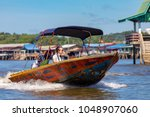 Small photo of Brunei Darussalam Bandar Seri March 17, 2018 BegawanWater taxi speeds through the waterways of Kampong Ayer, the water village