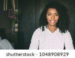 portrait of a pretty black... | Shutterstock . vector #1048908929