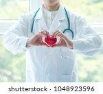 cardiovascular disease doctor... | Shutterstock . vector #1048923596