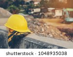 yellow helmets and gloves on... | Shutterstock . vector #1048935038