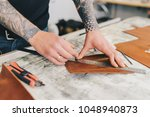 leather craftsman working... | Shutterstock . vector #1048940873