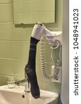 drying wet socks with a... | Shutterstock . vector #1048941023