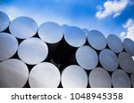 stack of aluminium billets | Shutterstock . vector #1048945358