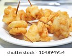pieces of fish and shrimps breaded and fried served as tapas - stock photo