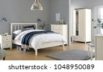 Stock photo cozy modern bedroom interior with bed 1048950089