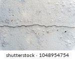 cracked concete wall   Shutterstock . vector #1048954754