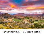 aerial view of highway road... | Shutterstock . vector #1048954856