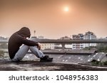 young asian man sitting on...   Shutterstock . vector #1048956383