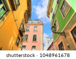 colorful streets of lisbon | Shutterstock . vector #1048961678
