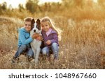 family time. brother and sister ... | Shutterstock . vector #1048967660