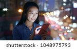 woman use of smart phone over... | Shutterstock . vector #1048975793