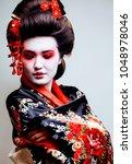 young pretty geisha in kimono... | Shutterstock . vector #1048978046