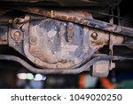 Small photo of Close-up shot of old car rustic rear axile