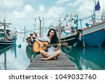 beautiful young brunette girl... | Shutterstock . vector #1049032760