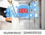Small photo of Medical Doctor with stethoscope and word ANEMIA, aplastic anemia in Medical network connection on the virtual screen on hospital background.Technology and medicine concept.