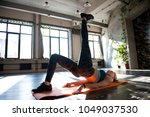 sporty girl trains on the mat... | Shutterstock . vector #1049037530