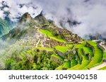 machu picchu in peru   ruins of ... | Shutterstock . vector #1049040158