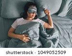 woman sleep in eye patch in...   Shutterstock . vector #1049052509
