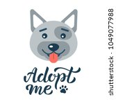 adopt me   dog with hand...   Shutterstock .eps vector #1049077988