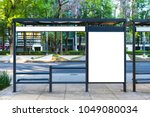 bus stop add by an avenue | Shutterstock . vector #1049080034