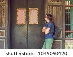 man tourist on the street in... | Shutterstock . vector #1049090420