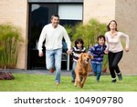 Stock photo happy family running after a dog outdoors 104909780