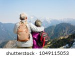 rear view of senior couple... | Shutterstock . vector #1049115053