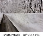 endless railway in the winter... | Shutterstock . vector #1049116148