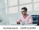 young man working on a project...   Shutterstock . vector #1049116589
