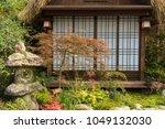 stone lantern in japanese... | Shutterstock . vector #1049132030