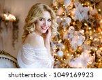 beautiful sexy lady in elegant... | Shutterstock . vector #1049169923