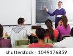pupils listening the... | Shutterstock . vector #1049176859