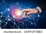 human hand point in the center... | Shutterstock . vector #1049197883