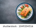 grilled salmon garnished with... | Shutterstock . vector #1049204516