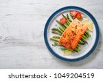 grilled salmon garnished with... | Shutterstock . vector #1049204519