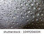 water drop on a steel...   Shutterstock . vector #1049206034