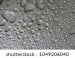 water drop on a steel...   Shutterstock . vector #1049206040