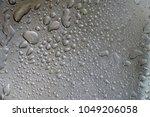 water drop on a steel...   Shutterstock . vector #1049206058