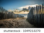 fenced path to the beach of la...   Shutterstock . vector #1049213270