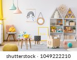 wooden crate and yellow pouf in ... | Shutterstock . vector #1049222210