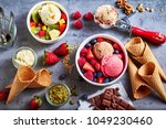 fresh fruit with scoops of... | Shutterstock . vector #1049230460