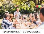 family celebration or a garden... | Shutterstock . vector #1049230553
