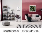 metal chair and grey sofa with... | Shutterstock . vector #1049234048