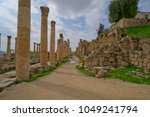 columns and broken wall  jerash ... | Shutterstock . vector #1049241794