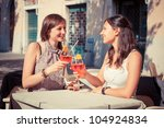 two young women cheering with... | Shutterstock . vector #104924834