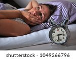 woman can not sleep and is... | Shutterstock . vector #1049266796
