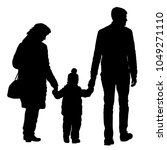 silhouette of happy family on a ... | Shutterstock . vector #1049271110